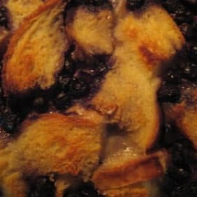 Very close up view of blueberry bread pudding.