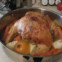 Roasted chicken in a stainless steel pain.