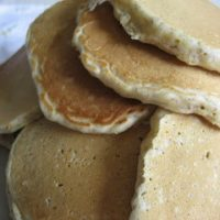 Several pancakes in a pile.