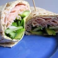 Turkey wrap on a blue plate.