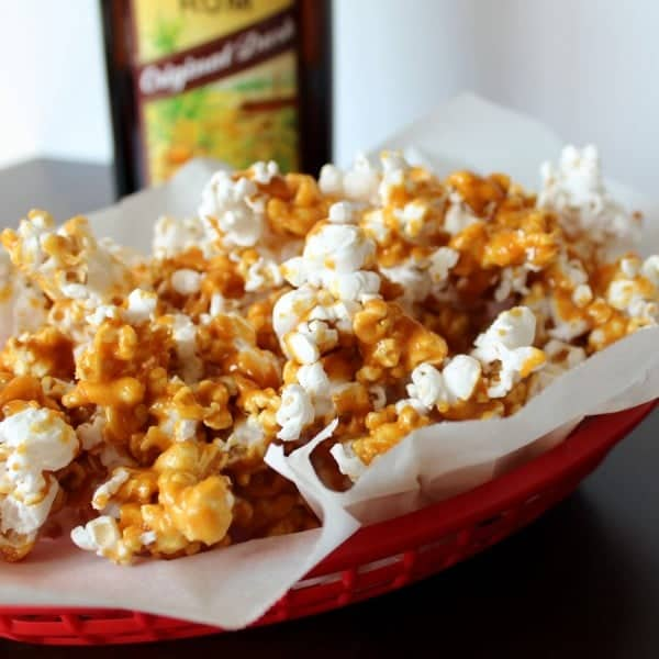 Side view of caramel corn in basket.