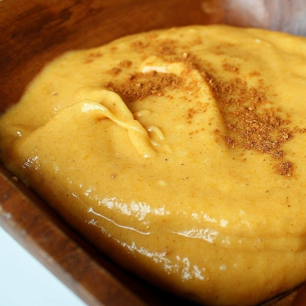 Close up view of a pumpkin pie dip sprinkled with pumpkin pie spice.