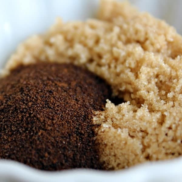 Very closeup of espresso powder and brown sugar side by side.