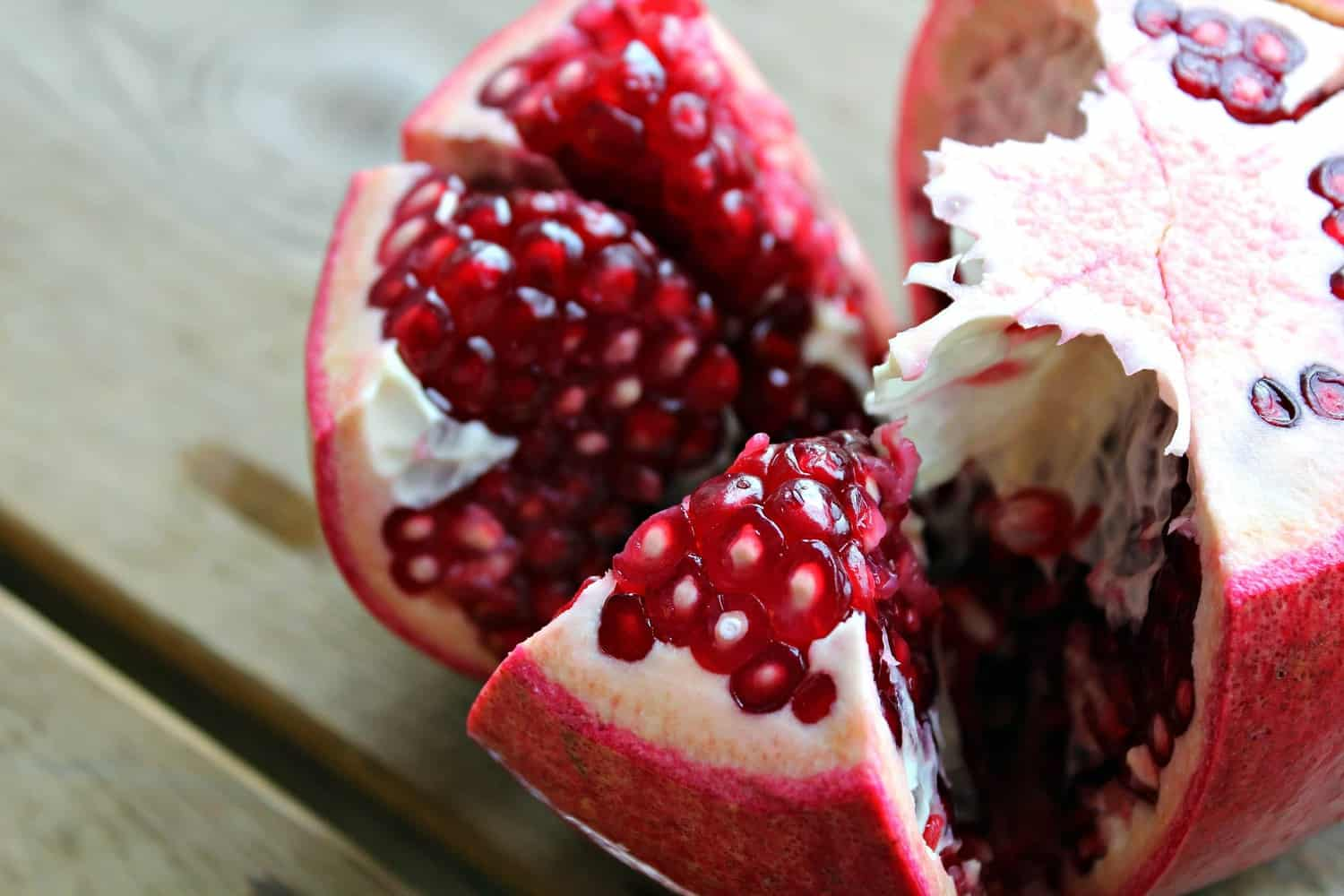 Fresh pomegranate cut open to show inside.