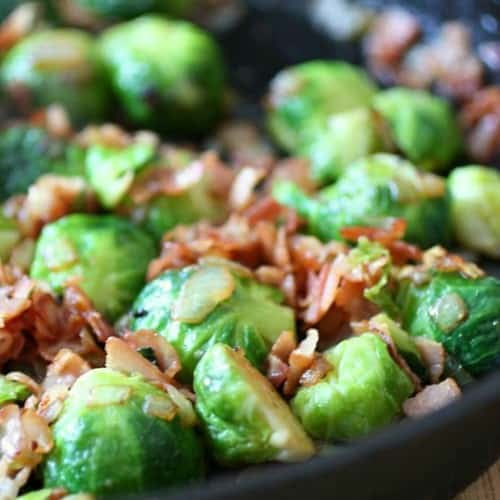 Brussels sprouts in black cast iron skillet.