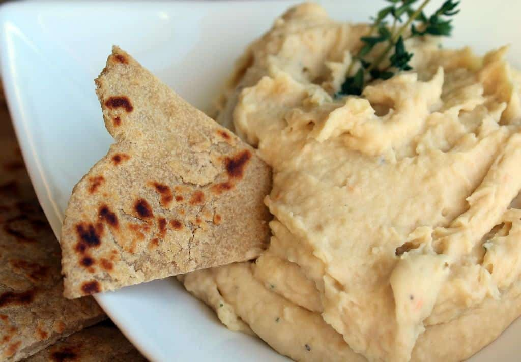 Closeup of dip with flatbread wedge inserted.