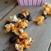 Caramel corn scattered over weathered deck boards.