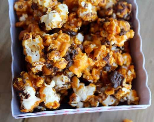 Closeup of caramel corn in container.