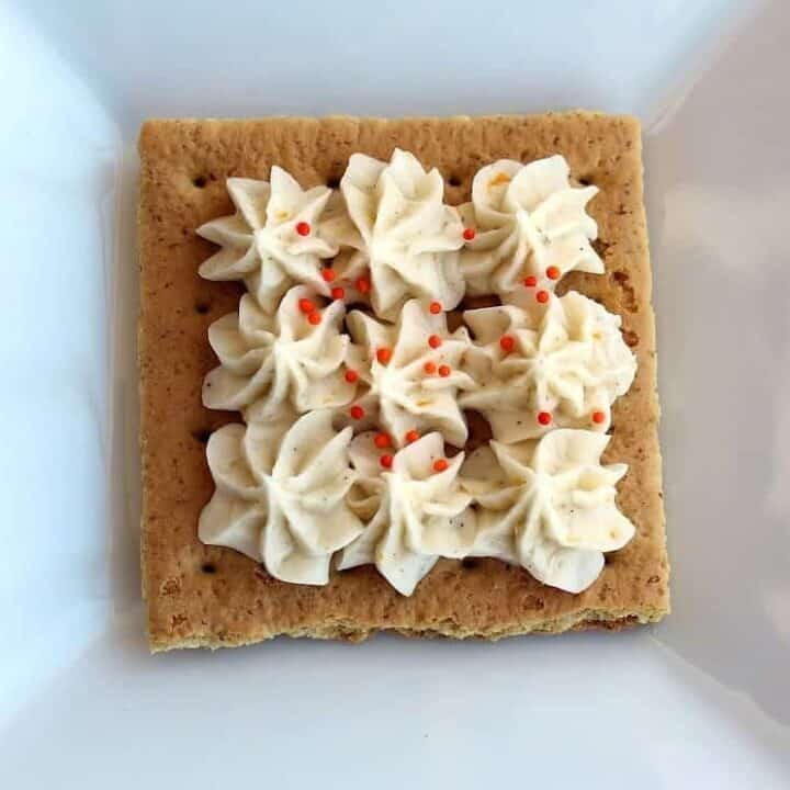 Overhead of single graham cracker frosted decoratively.