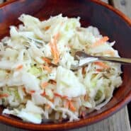 Healthy coleslaw in wooden salad bowl, with fork.