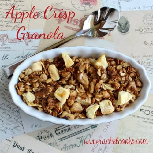 "A shallow white dish containing apple granola photo, overhead view. Background is a variety of antique post cards. Text overlay reads ""Apple crisp grandola. www.rachelcooks.com""."