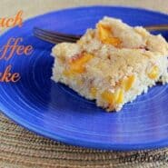 "Front view of a piece of peach coffee cake on a bright blue plate with fork. Text overlay reads ""Peach Coffee Cake."""