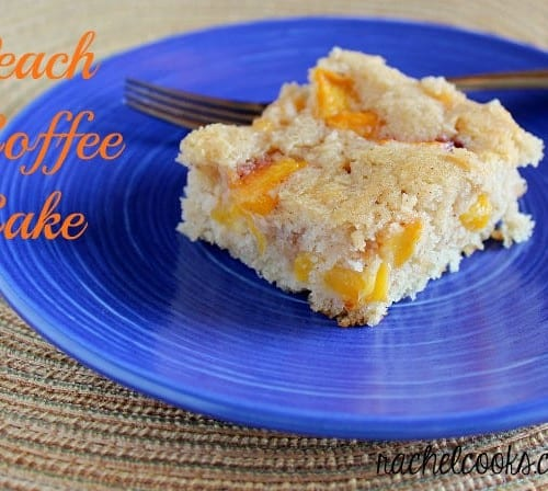 """Front view of a piece of peach coffee cake on a bright blue plate with fork. Text overlay reads """"Peach Coffee Cake."""""""