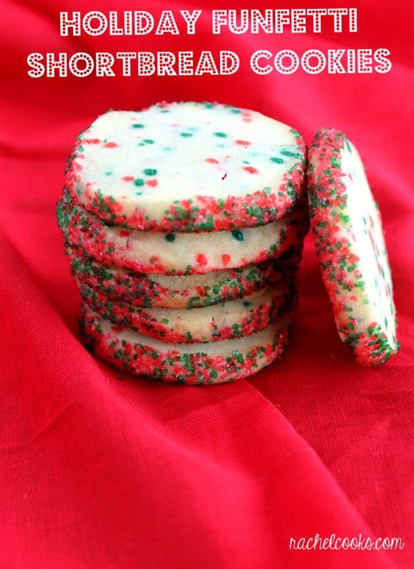 Holiday Funfetti Shortbread Cookies stacked on top of a red tablecloth