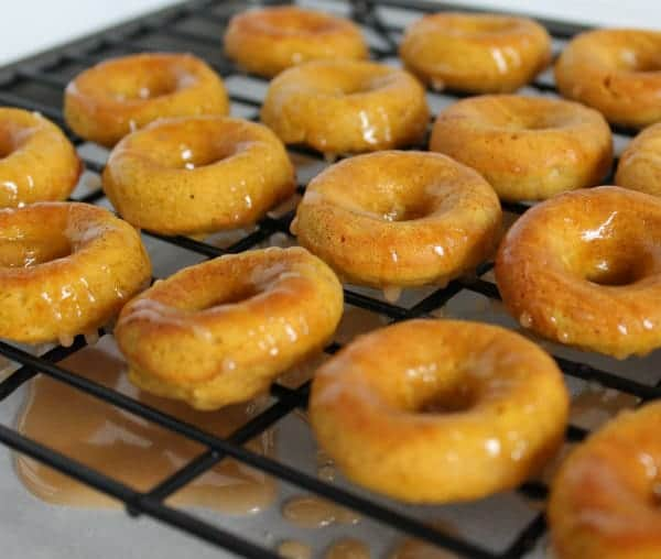 Mini pumpkin doughnuts with a sweet cider and rum glaze are perfect for a fall breakfast or snack. Bonus: They are baked, not fried, so you can feel good about eating them! Get the easy recipe on RachelCooks.com!