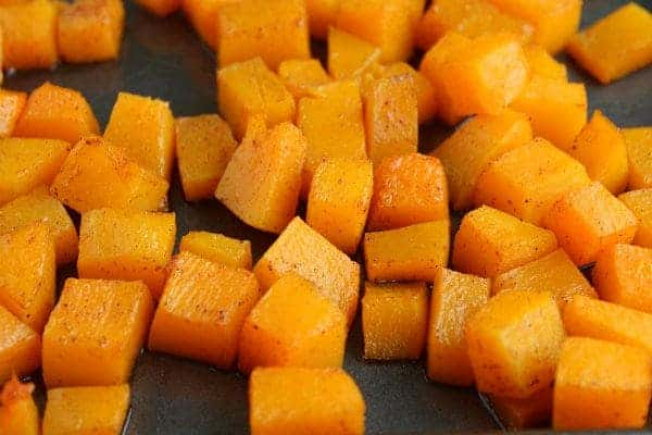 his roasted butternut squash that is both spicy and sweet is 100% perfect! It's an easy and healthy side dish that the whole family will love. Get the recipe on RachelCooks.com!