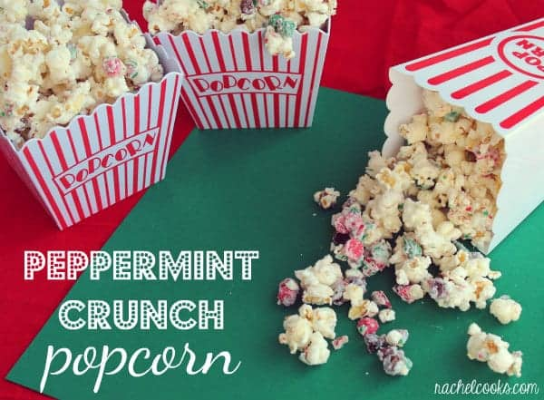 """Popcorn in three popcorn containers, one spilling out onto a green surface. Text overlay reads """"Peppermint Crunch Popcorn."""""""
