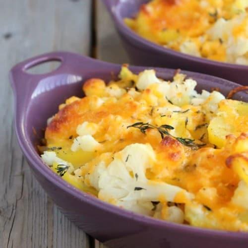 Partial image of potato cauliflower bake in individual purple ramekins.