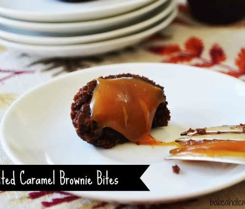 """One salted caramel brownie bite on a round white plate, with bite taken. Text overlay reads """"Salted Caramel Brownie Bites."""""""