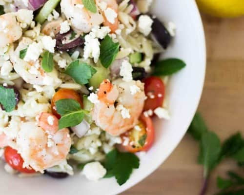Overhead view of a shrimp and orzo salad.