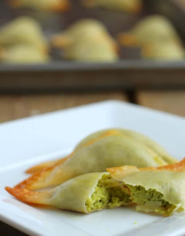 Side view of baked pea dumpling split in half, displaying filling.