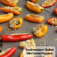 Stuffed mini peppers arranged on baking sheet.