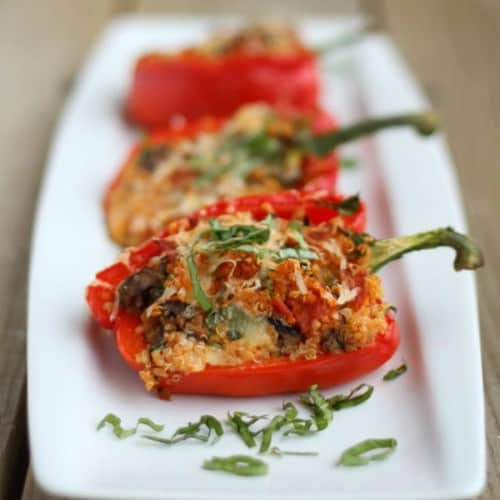Image of quinoa stuffed bell peppers with pepperoni, mushrooms, cheese, and pizza sauce.