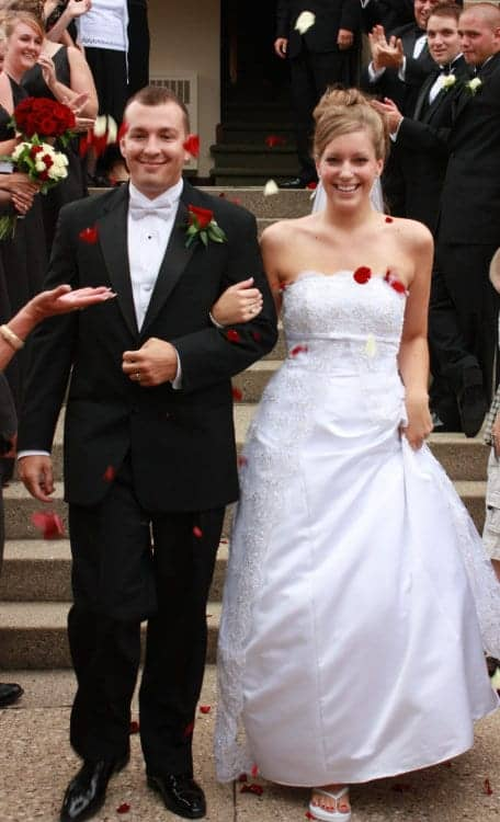 Wedding picture of bride and groom leaving church.