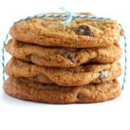 Stack of four chocolate chip cookies tied with blue and white string.