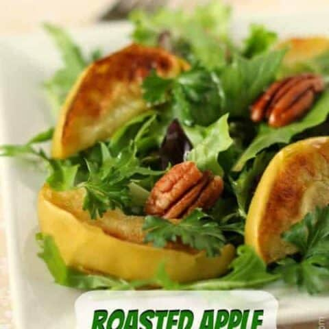 Closeup of salad with broiled apples, pecans and mixed greens.