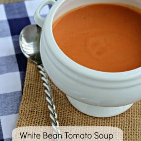 White footed ceramic bowl containing tomato soup.| RachelCooks.com