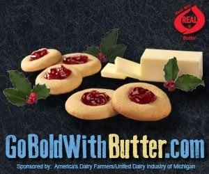 """Go Bold with Butter.com"" logo, with jam filled cookies, holly, and a stick of sliced butter."