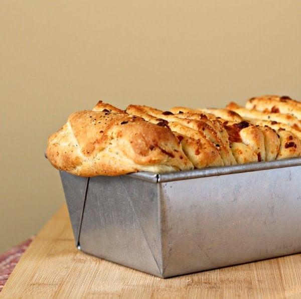 Front partial view of bread in baking tin.