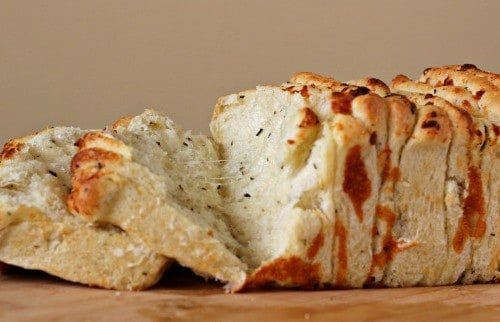 Front view of pull-apart bread with a couple slices separated.