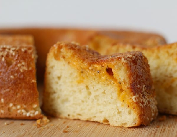 Closeup of a slice of cheesy bread.