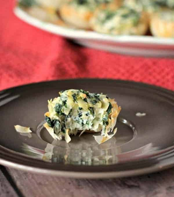 A delicious and elegant party appetizer that you can prep a day or two in advance, these Spinach Artichoke Phyllo Bites will be a hit at your next party. Get the easy recipe on RachelCooks.com!