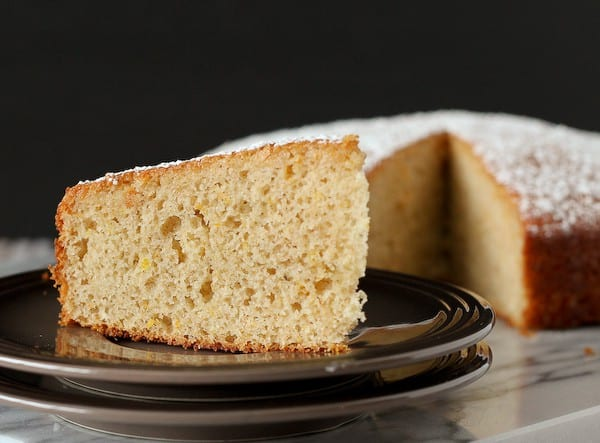 This yogurt cake has so much great flavor thanks to clementines and vanilla beans that you won't even notice that it uses whole wheat flour and yogurt! Get the cake recipe on RachelCooks.com!
