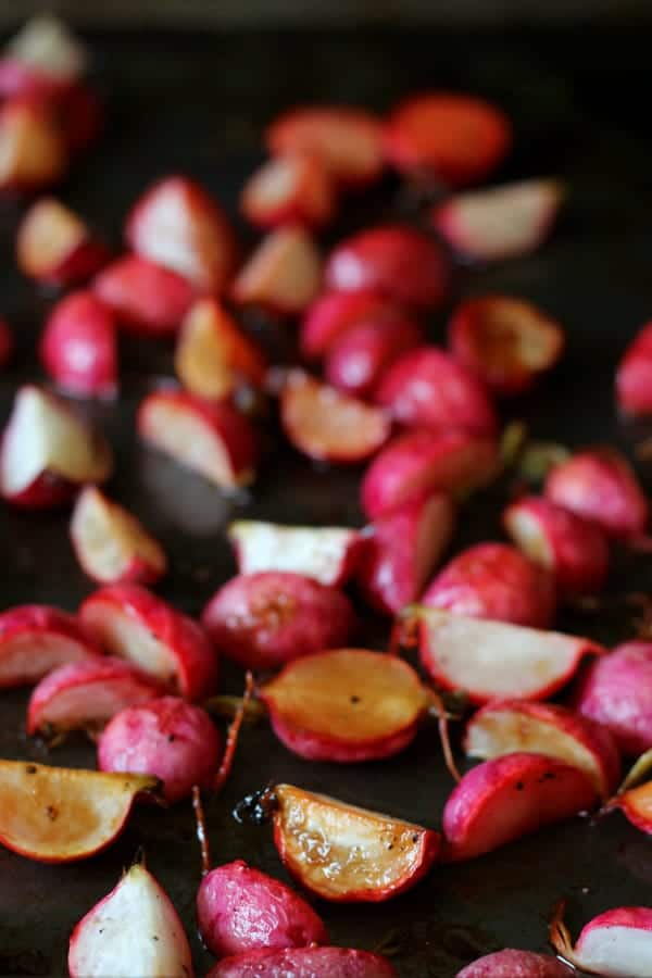 Roasted radishes on sheet pan.