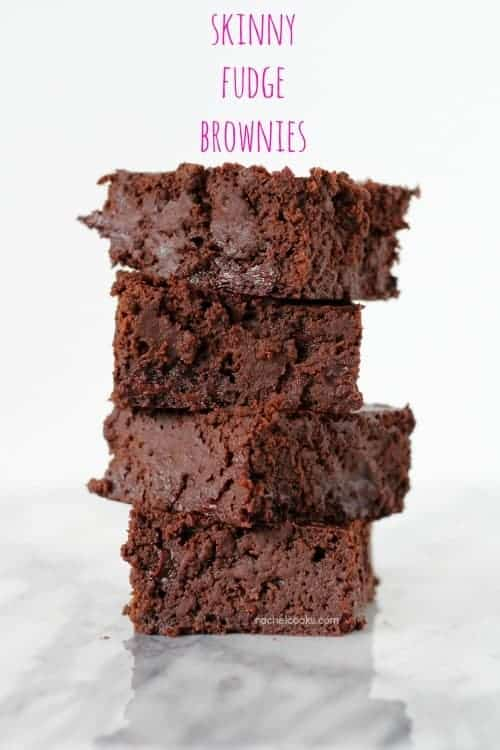 "Four brownies stacked on white marble surface. Text overlay reads ""Skinny fudge brownies."""