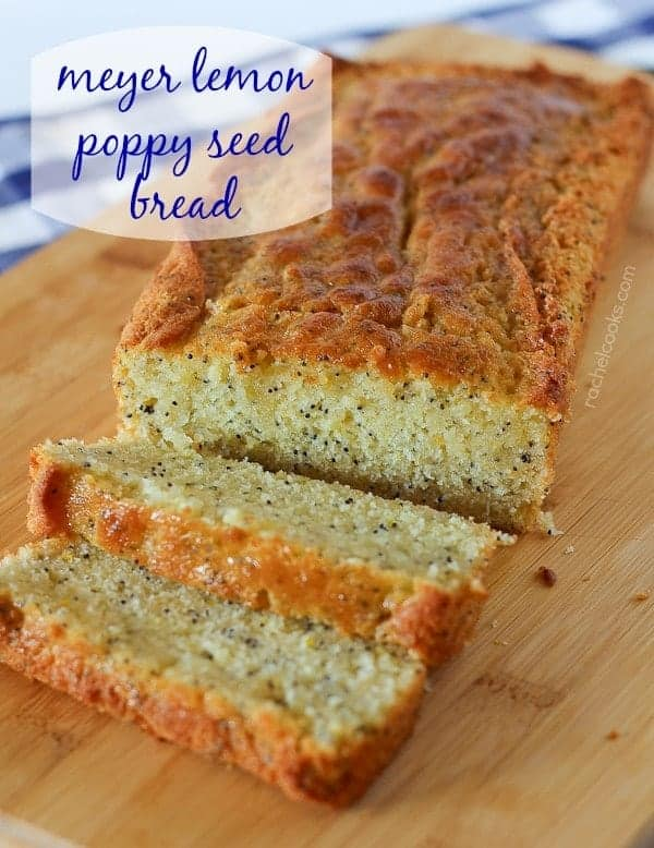 "Image of a loaf of lemon poppy seed bread with two slices cut off. A text overlay is also present that reads ""meyer lemon poppy seed bread."""