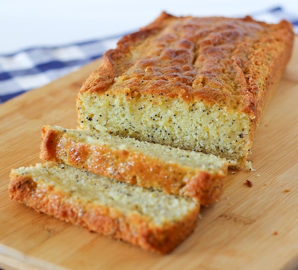 Image of a lemon poppy seed bread, with two slices cut off.