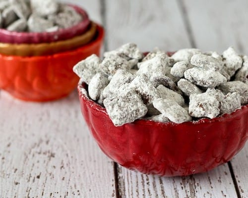 Small red bowls containing puppy chow.