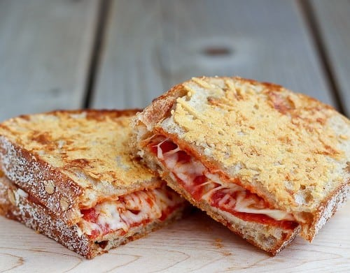 Pepperoni Pizza Grilled Cheese with a crispy parmesan cheese crust - so good you'll never go back to plain grilled cheese! Find the recipe on RachelCooks.com