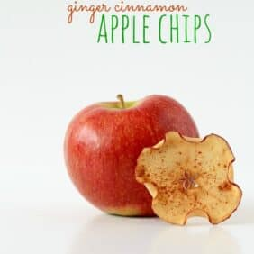 "One apple chip, propped on a red apple, with text overlay ""Ginger Cinnamon Apple Chips."""