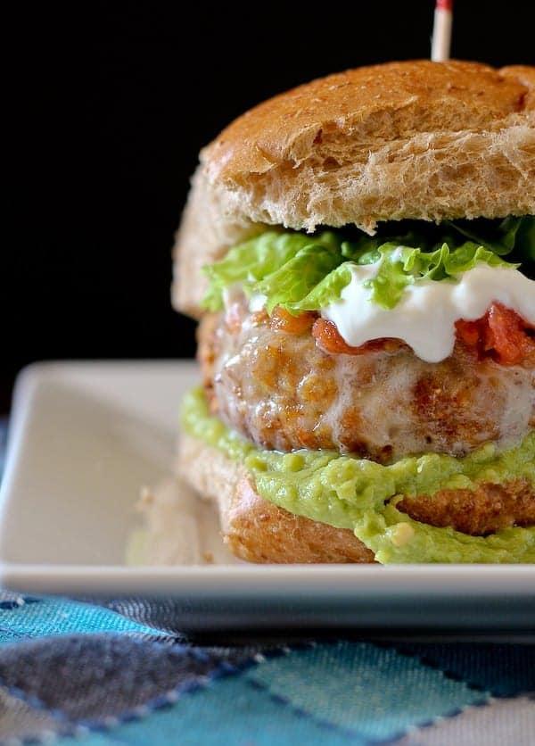 partial closeup image of turkey burger on bun.