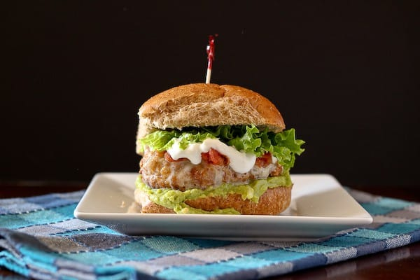 Taco turkey burger on bun with toppings.