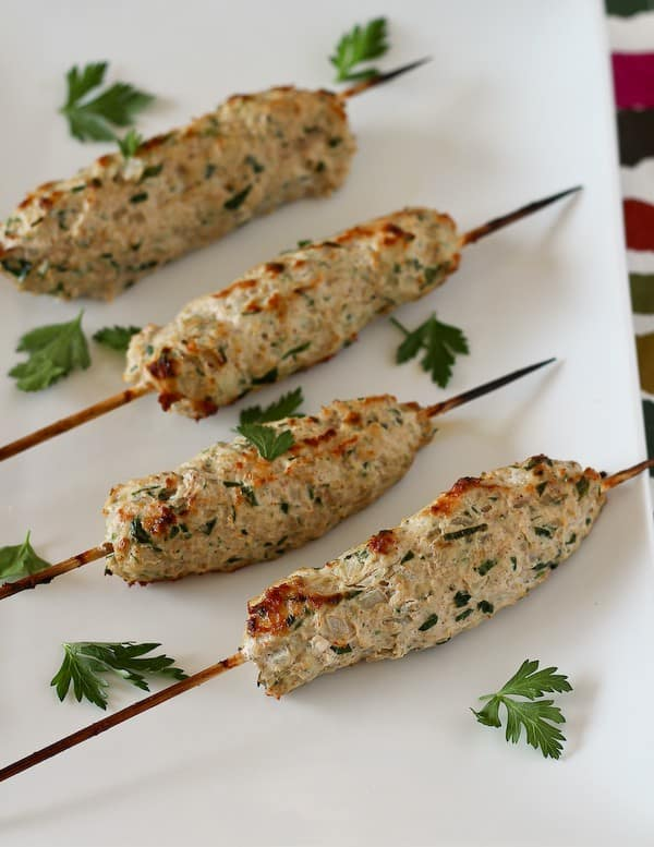 This Chicken Kofta is made with ground chicken flavored with parsley, onion, and great spices. It is healthy, exciting and easy to prepare. It would be great with ground turkey too! Get the recipe on RachelCooks.com!