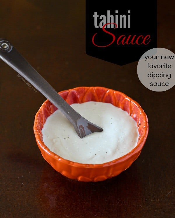 """Small red bowl filled with tahini sauce with spoon inserted. Text overlay reads """"Tahini Sauce, your new favorite dipping sauce."""""""