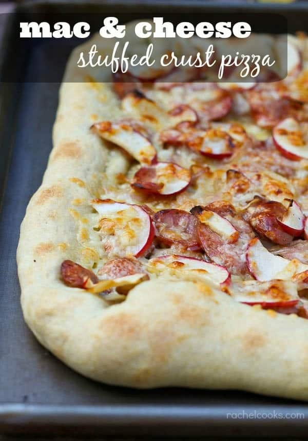 """Pizza on a sheet pan, text overlay reads """"mac and cheese stuffed crust pizza"""""""