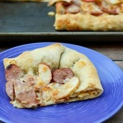 The apple and chicken sausage pizza is full of great fall flavors -- and has a fun macaroni and cheese surprise waiting in the stuffed crust! Recipe on RachelCooks.com